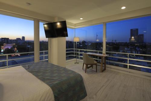 A balcony or terrace at Hotel Velvet Plaza