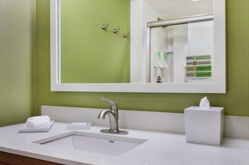 A bathroom at Home2 Suites Dover