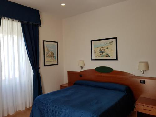 Letto o letti in una camera di Hotel L'Isola