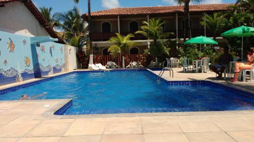 The swimming pool at or close to San Bernardo Apart-Hotel
