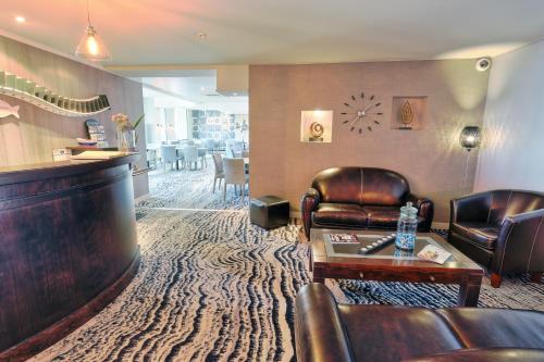 The lobby or reception area at Hotel de la Plage
