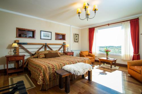 A bed or beds in a room at Estancia La Estela