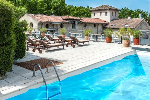 The swimming pool at or near Hôtel Cloitre Saint Louis Avignon