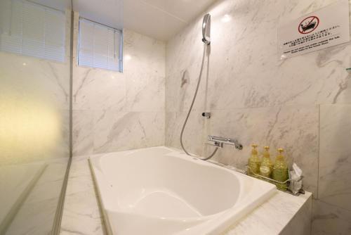 A bathroom at Goethe Hotel Omori