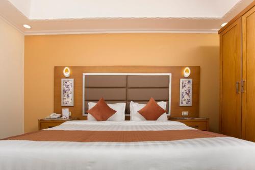 Cama ou camas em um quarto em Hotel Ritaj Alsahel