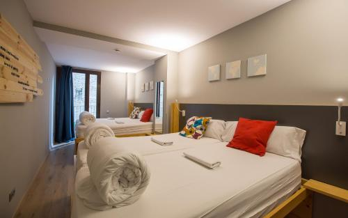 A bed or beds in a room at Yeah Barcelona Hostel