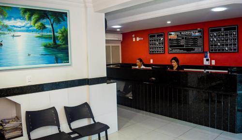 The lobby or reception area at Hotel Marquetti