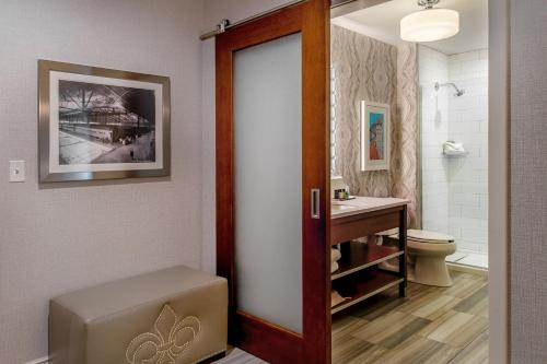 A bathroom at St. Louis Union Station Hotel, Curio Collection by Hilton