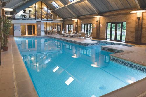 The swimming pool at or near Best Western Plus Knights Hill Hotel & Spa