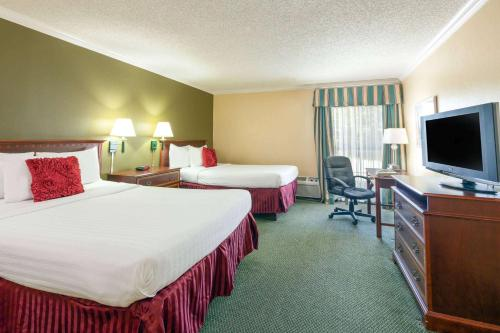 A bed or beds in a room at Extend-a-Suites - Amarillo West
