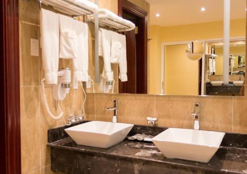A bathroom at Ramada by Wyndham Princess Georgetown