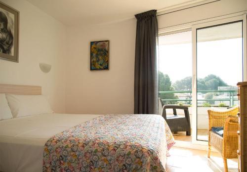 Cama o camas de una habitación en Apartaments Plus Costa Brava Estartit