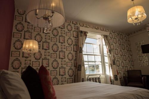 A bed or beds in a room at Sweeney Hall Hotel