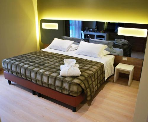 A bed or beds in a room at Idea Hotel Plus Savona