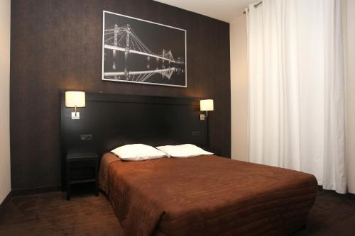Een bed of bedden in een kamer bij Trocadero