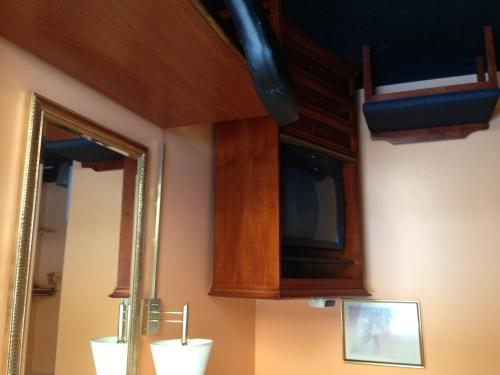 A television and/or entertainment center at Ranch House Motel Marksville