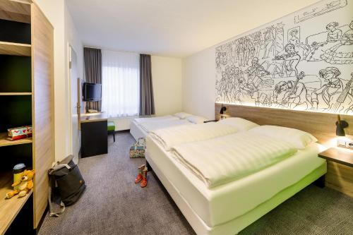 A bed or beds in a room at ibis Styles Halle