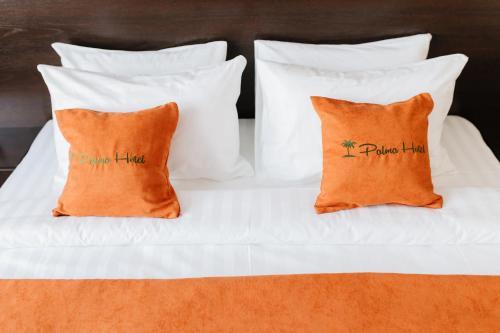 Кровать или кровати в номере Hotel Palma