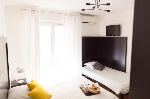 A bed or beds in a room at Esperanto
