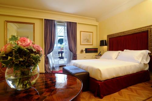 A bed or beds in a room at Hotel Villa Duse