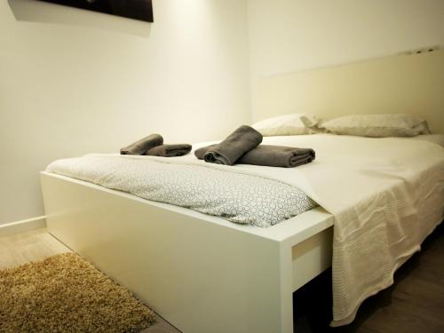 Säng eller sängar i ett rum på Perla Seven Apartments and Rooms