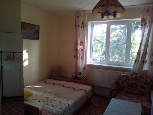 Кровать или кровати в номере ГОСТЕВОЙ ДОМ