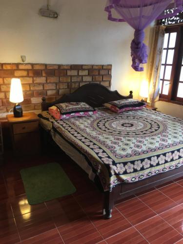 Кровать или кровати в номере Petters Beach Inn