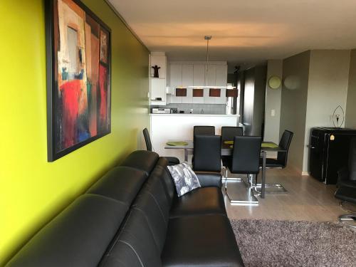 Een zitgedeelte bij Appartement voor 6 personen in Koksijde met zeezicht