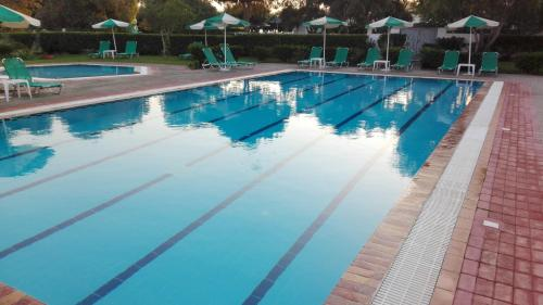 The swimming pool at or near Pylea Beach Hotel