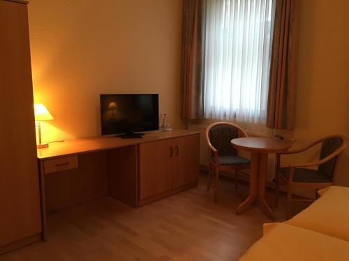 Телевизор и/или развлекательный центр в Hotel Steinkrug