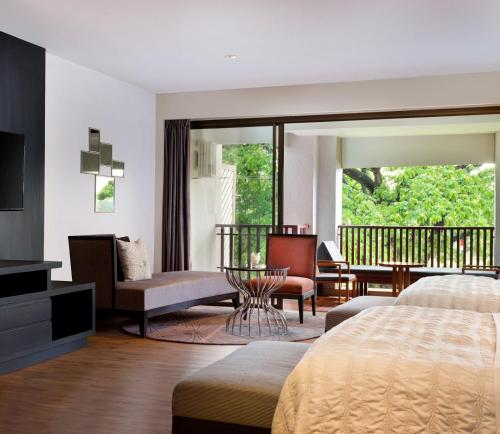 A seating area at Le Meridien Chiang Rai Resort, Thailand - SHA Certified