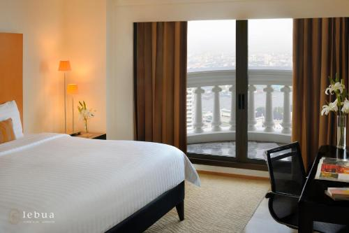 A bed or beds in a room at Tower Club at lebua (The World's First Vertical Destination)