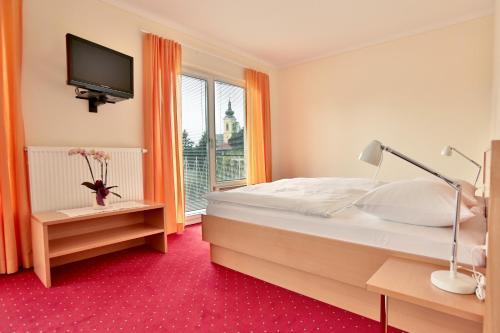 Ein Bett oder Betten in einem Zimmer der Unterkunft Hotel Reineldis