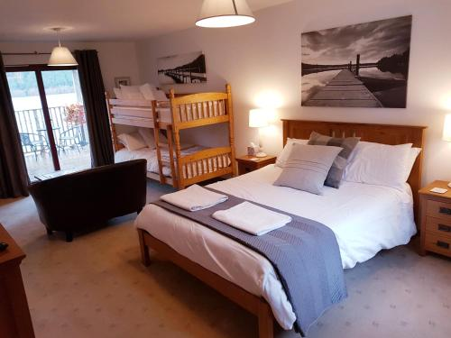 A bed or beds in a room at Letterfinlay Lodge House