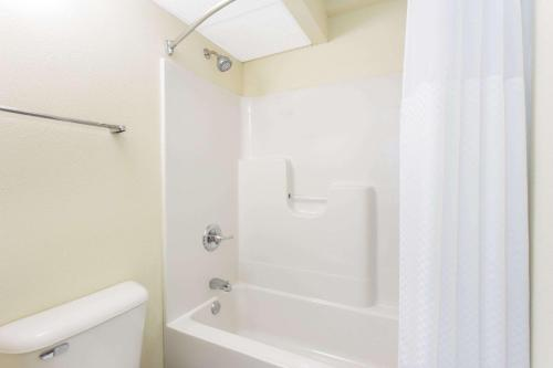 A bathroom at Days Inn by Wyndham Dubuque