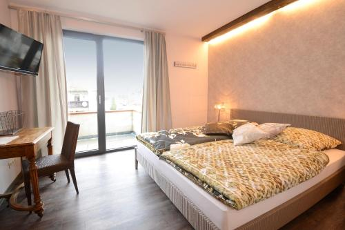 A bed or beds in a room at Vinotel Dollt-Kern