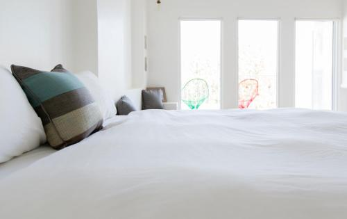 A bed or beds in a room at Mare Cielo