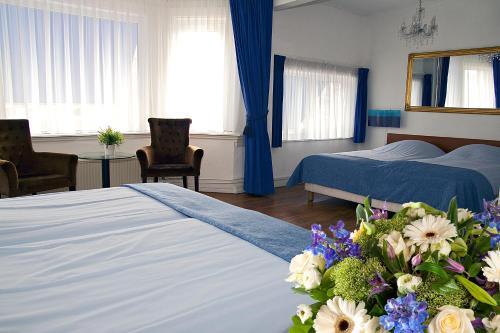 Un ou plusieurs lits dans un hébergement de l'établissement Hotel Albion