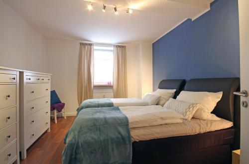 Ein Bett oder Betten in einem Zimmer der Unterkunft Wildburgmühle
