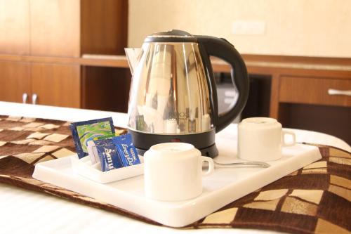Coffee and tea making facilities at Kc Inn