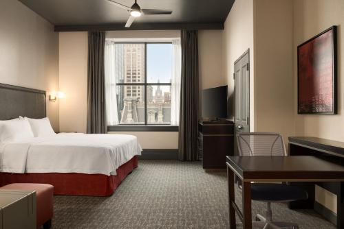 A bed or beds in a room at Homewood Suites By Hilton Milwaukee Downtown