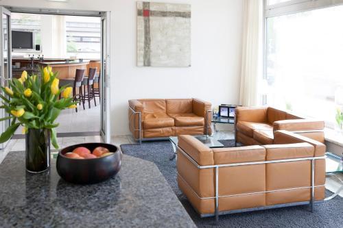 Ein Sitzbereich in der Unterkunft Hotel Senator München