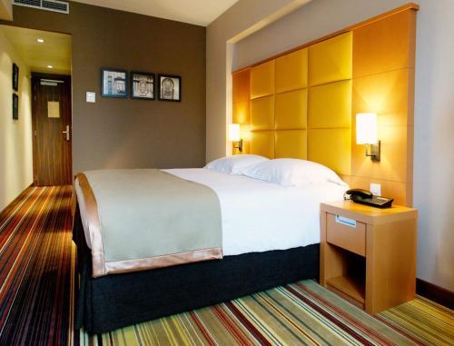 Cama o camas de una habitación en Newhotel Charlemagne