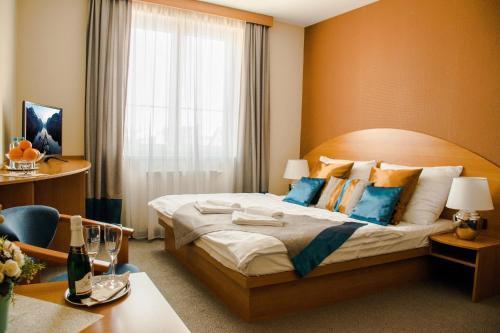 Postel nebo postele na pokoji v ubytování Penzion Fontana
