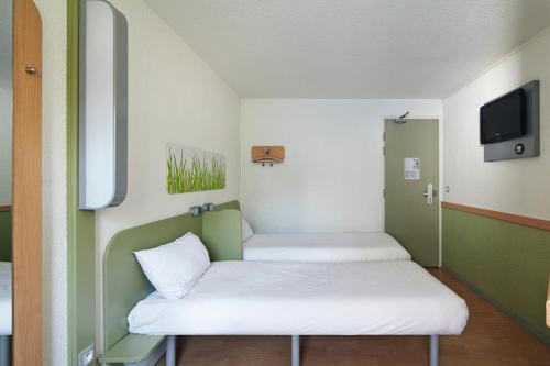 Un ou plusieurs lits dans un hébergement de l'établissement ibis budget Blois Centre