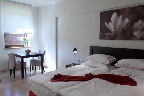 A bed or beds in a room at Euphoria Club Hotel