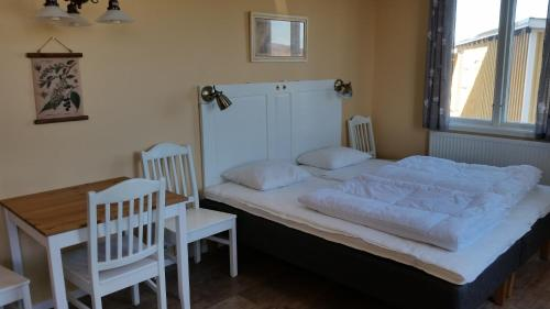 Säng eller sängar i ett rum på Björkängs Vandrarhem