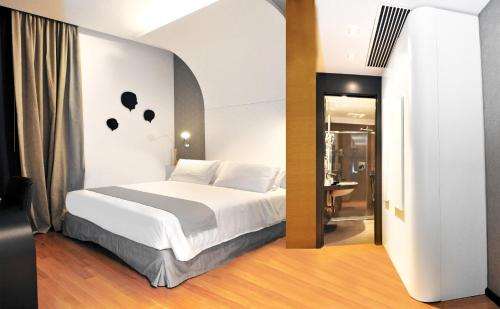 A bed or beds in a room at Culture Hotel Centro Storico