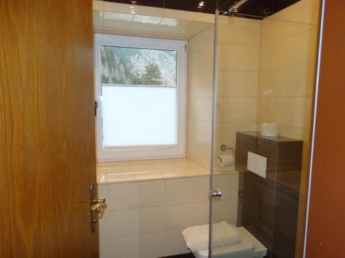 Łazienka w obiekcie Gasthof Durigon