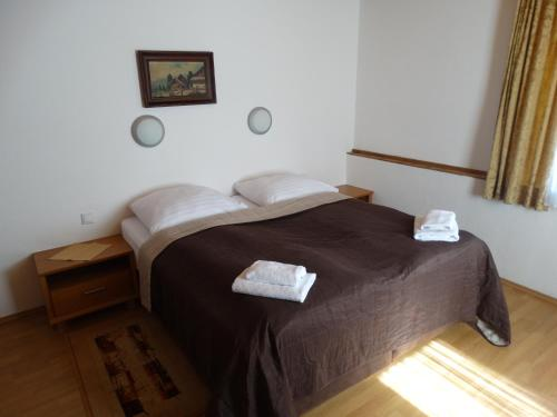 Łóżko lub łóżka w pokoju w obiekcie Gasthof Durigon